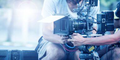 Professionals operating cinematography equipment